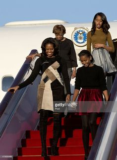 First Lady Michelle Obama with her mother Marian Robinson, daughters Sasha Obama and Malia Obama arrives at Beijing Capital International Airport on March 20, 2014 in Beijing, China. The first lady arrived in Beijing with her mother, Marian Robinson, and daughters to kick off a six-day tour where she will focus on education and cultural exchange.