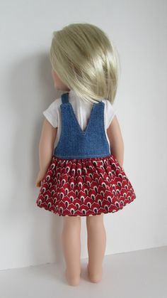 Jumpers with denim bibs and gathered print skirts are in style right now, and your 14.5 doll will want one to wear to school and many other places. The jumper has a denim bib with a functional pocket on the front. It has buttons on the front of the bib for appearance. There are snaps on the back of the straps and the bib back. The skirt is made from cotton print and is gathered onto the bib. The bib is lined with the skirt fabric. I modified the top portion of a Forever 18 Inches pattern and…