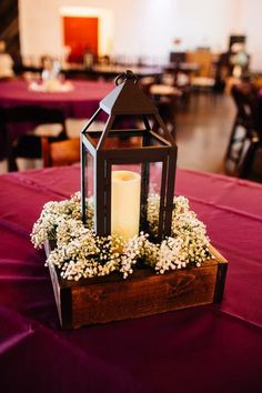 Rustic wedding centerpiece idea - metal lanterns in wooden boxes with baby's breath {Amber Rhodes Photography}