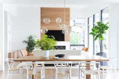 We could spend our whole Saturday in this standout space full of natural wood touches. Design by Phot Dining Table Lighting, Oak Dining Table, Dining Rooms, Contemporary Dining Chairs, Contemporary Furniture, Interior Styling, Interior Design, Home Furnishings, Fireplaces