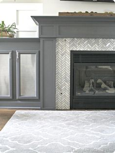 Tiling a fireplace surround (Thrifty Decor Chick). Love the herringbone tile surround and dark gray fireplace. Fireplace Remodel, Home Decor Inspiration, Fireplace Built Ins, Family Room, Home, Fireplace Surrounds, New Homes, Fireplace, High Heat Paint
