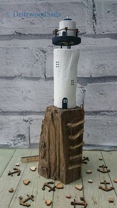 Check out this item in my Etsy shop https://www.etsy.com/uk/listing/508520445/salvaged-wood-driftwood-lighthouse-scene