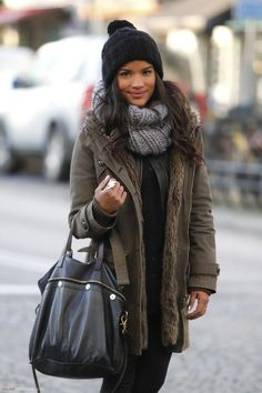 casual cozy chic fall/winter look: army green puffy jacket coat and chunky grey infinity scarf add some neutral color tones to break up the all-black ensemble | topped off with a beanie for added style + warmth!