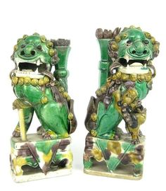 Two famille-verte incense burners, Kangxi Period (1662-1722), in the form of Buddhist lions. 20.3 cm and 19.3 cm high