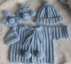 Baby boy's sweater outfit made from this free Newborn Layette pattern from redheart.