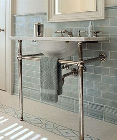 Gorgeous - love the tiles and sink, but don't love that there's no practical storage