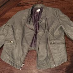 Lauren Conrad faux leather jacket Grey faux leather 3/4 length sleeve zip up jacket. Great jacket to go with any outfit! There are two zipper pockets, one on each side and zippers at the end of the sleeves Lauren Conrad Jackets & Coats