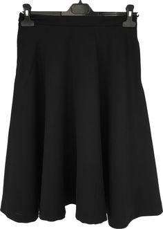 Falda de capa con bolsillos, tejido con relieve. Tallas M, L y XL.