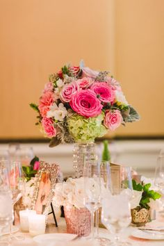 Hydrangea, Rose Arrangement on Crystal Stand  Photography: Patrick Moyer Read More: http://www.insideweddings.com/weddings/vintage-inspired-alfresco-ceremony-fairy-tale-ballroom-reception/1030/
