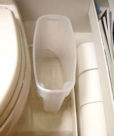 Use a dry food container as a wastebasket. | 37 RV Hacks That Will Make You A Happy Camper