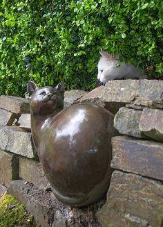 Cat with a Georgia Gerber cat bronze statue
