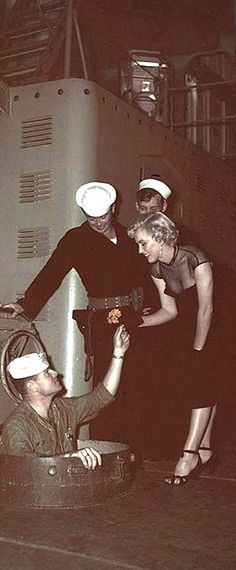 Marilyn Monroe is given a flower by a sailor on the navy ship USS Benham. Marilyn visited the ship as publicity for Century Fox who were promoting a new movie about submarines in WWII. Photo by John Florea, June Carole Lombard, Clark Gable, Norma Jean Marilyn Monroe, Queens, Candle In The Wind, Norma Jeane, Poses, Vintage Hollywood, Mafia