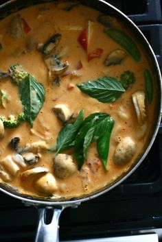 Indian Curry with Garlic, Ginger, Coconut Milk, Lime, Mushrooms, and Thai Basil Leaves.