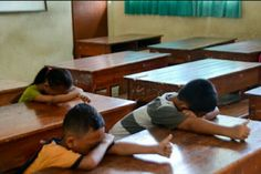 """Our students playing their favorite game, the """"sleeping game""""."""