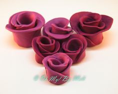 Available at: http://www.ohmybymeli.com.au/  Handmade clay rose ornament.