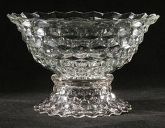 Large 14 two piece punch bowl, Fostoria America pattern #2056, dimensional cube pattern, 9 1/2t, with 14 cups, flared rims. Good condition.