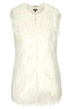 Stylish and warm   Topshop faux fur gilet vest.