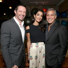 """Smiles all around! Hugh Jackman posed with George Clooney and Amal Clooney during the MPTF's 95th anniversarry celebration """"Hollywood's Night Under the Stars"""" at the MPTF Wasserman Campus in Woodland Hills, California."""
