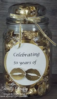 Yesterday I shared my handmade 50th wedding anniversary card made with the May Flowers Framelits Dies. It was designed to coordinate with a jar full of lots of Kisses for a 50th wedding anniversary gift. The idea started when I spotted gold wrapped Hershey Kisses with Almonds. Then I remembered my retired S.W.A.K