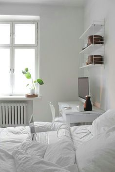 Best All White Room Ideas White Clean Bedroom Shelves Bedding 35 all-white room ideas. Discover photos of living rooms, bedrooms, kitchens, and bathrooms decorated in all white decor. Find monochrome white rooms that will inspire your own decor. Bedroom Workspace, Home, Home Bedroom, Room Decor, Small Bedroom, White Rooms, Clean Bedroom, Shelves In Bedroom, All White Room