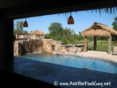 Outdoor Pool House/Bar with tiki thatching.