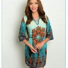 Teal/ brown dress. Teal/brown dress. This dress runs smaller in size the small is more like an extra smal the medium is more like a small. I have 1 small and 1 medium left. Dresses