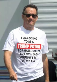 LMAO. You know I am beginnning to understand why they won't get it. It makes his supporters look incredibly stupid, greedy, and gullible. Love this shirt. Is this Tom Hanks?