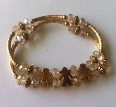 Pulsera doble cristal tipo swarovsky doble con niño y niña con oro by Be original https://www.facebook.com/BeOriginalJoyeria?ref=hl