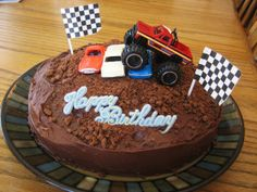 Blaze and the Monster Machines Birthday Cake Idea: Chocolate cake for a muddy base and toy monster truck and car toppers.