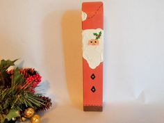 """Cute whimsical Santa figurine Hand crafted vintage Christmas decoration Chunky wood block painted red and white  Textured beard and trim 8"""" h x 1 1/2: l x 1 1/2"""" w  Unique gift for a Santa collector Very nice vintage condition as seen in photos  PCYSCV25W5SW10BL1182FL915 a vintage addiction, vintage figurine, christmas decoration, santa claus, santa figurine, chunky wood, wooden santa, hand painted, handcrafted, unique santa,  christmas tree, santa collector, red green white, christmas in…"""