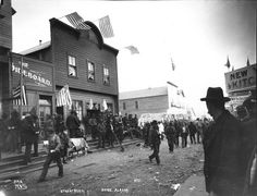 Buildings decorated with American flags, Nome, Alaska, ca. 1900.