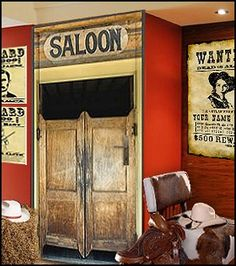 I really want to do swinging saloon doors for the nursery closet and I finally found a cute photo. This site also has many other great western theme room ideas.