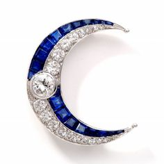 Antique 5.75 cts Art Deco Diamond Sapphire Platinum Moon Pin. This lovely antique deco diamond brooch pin is crafted in solid platinum. This pin is centered with 1 genuine round European diamond approx 0.90cttw, G-H color, VS1 clarity and accented with some 16 genuine round cut European diamonds approx 1.60cttw, G color, VS clarity, and 18 genuine french cut beautiful color royal blue genuine sapphires approx 3.50cttw, channel and bezel set