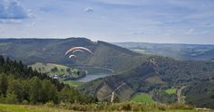 paragliding over the green valley of Coo ( Belgian Ardennes)