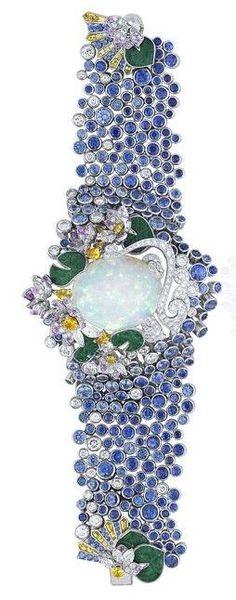 Fleur sacrée bracelet, Palais de la chance collection. White gold, diamonds, colored sapphires, chlorome lanite and one white opal of 31,44 cts.
