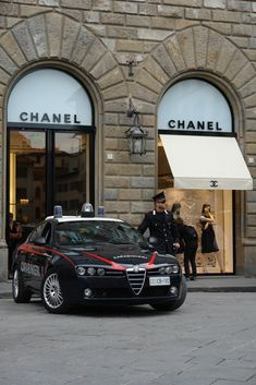 Best picture ever, CHANEL , an Alfa Romeo and your very own Carabinieri