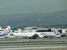 Cathay Pacific Air 'One World' jet at LAX Airport in Los Angeles, California