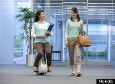 Honda unveiled an updated version of a robotic unicycle which it said could revolutionize travel for people with disabilities.