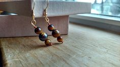 Check out this item in my Etsy shop https://www.etsy.com/listing/226200016/drop-gold-tone-earrings-with-tigers-eye