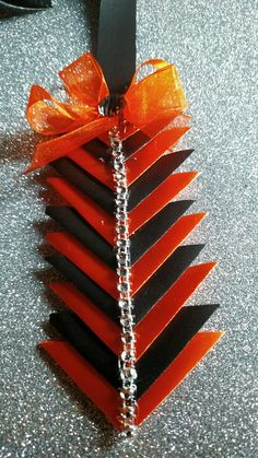 Orange and black Chevron homecoming mum spirit chain with organza ribbon bow and rhinestones. Designed by Crafty bug