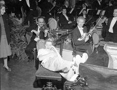 "Katharine Hepburn (aglow) is serenaded on the set of ""Song of Love"" in 1947"