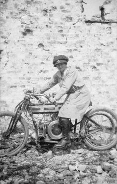 Mairi Chisholm in Red Cross uniform and on her 4hp Douglas motorcycle in Pervyse, 1916.