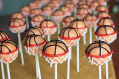 Soccer ball and basketball graduation cake pops - by Courtney's Cake Pops  www.facebook.com/fmcakepops