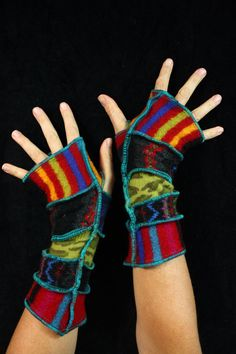 This great pair of arm warmers made from bits of recycled knits. They have a funky palette of bold stripes.