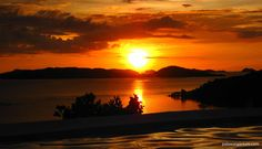 After a long day of island hopping, relax and enjoy the sundown at Busuanga Bay.