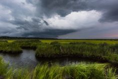 Wide angle photograph of severe weather clouds moving in over the Cedar Run Dock Road salt marsh.