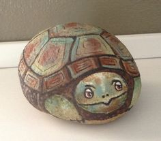 A new little turtle painted on a rock