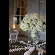 Wedding Decor: Escort Card Table Displays, the envelopes are propped up on their flaps