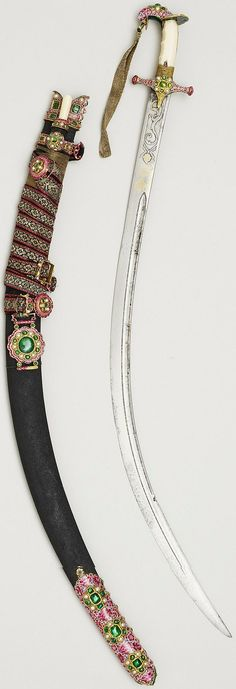 Persian shamshir (sabre), with scabbard, bi-knife and sword belt, 1800s, Blade, inlaid with Persian couplets and dedications, watered crucible steel, seed pearls, gold; hilt, ivory, gold, enamel, pearls; scabbard, wood, fish-skin; belt, canvas, gold thread; mounts, enamel, gold, emeralds, pearls, The Royal Collection.