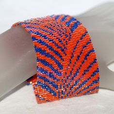 To and Fro...  Peyote bracelet in brilliant orange and midnight blue.  $ 75